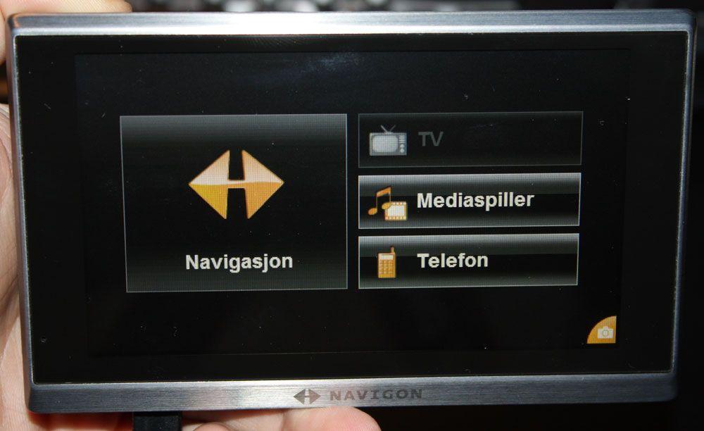 Om du absolutt må, kan du høre musikk og se video på Navigon 8410.