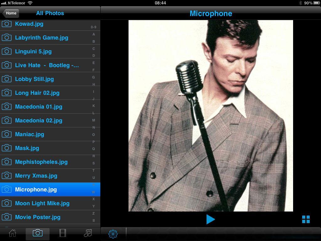 Bilder kan vises som forhåndsvisning, som lysbildeserie, i et rutenett eller i full størrelse. Slik forhåndsvisningen ut på en iPad.