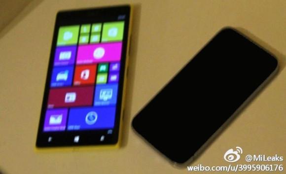 Nokia Lumia 1520 Mini ved siden av en iPhone.