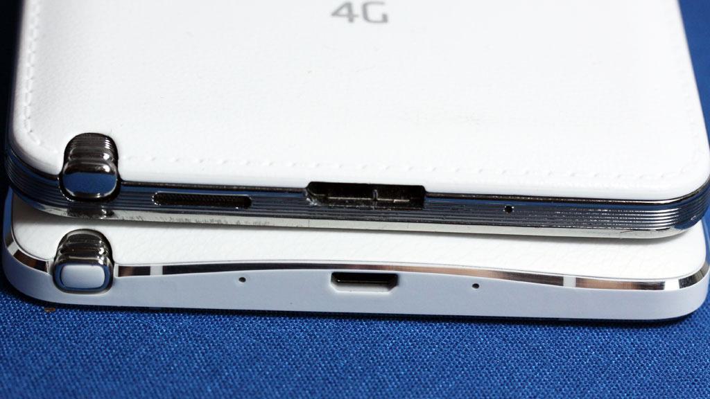 Note 3 på toppen, Note 4 underst. De små hullene på Note 4 er til mikrofonene. Legg også merke til at Note 4 ikke har USB 3.0-kontakt, slik Note 3 har. Foto: Espen Irwing Swang, Tek.no