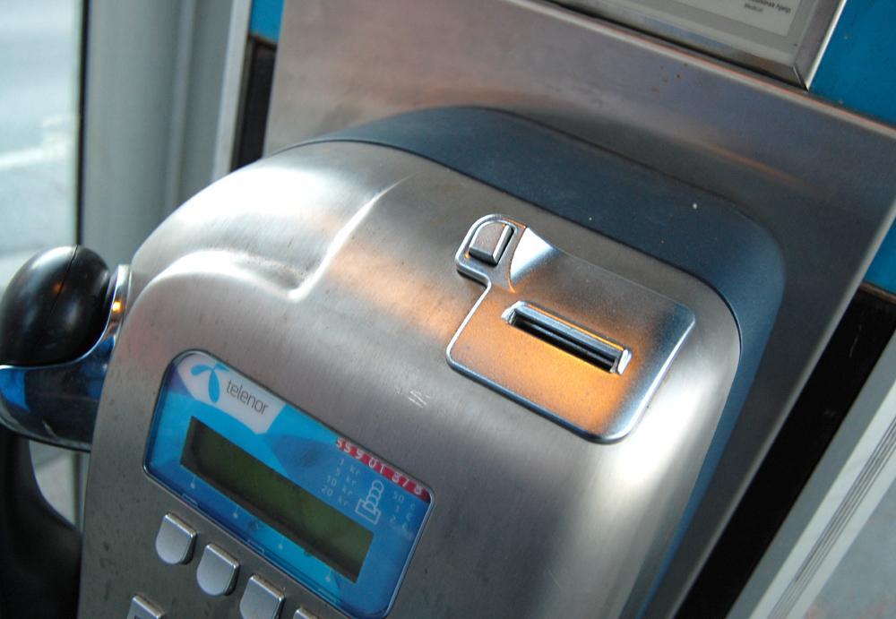 Telefonkioskene tar fortsatt mynter. Men veldig mange av dem.