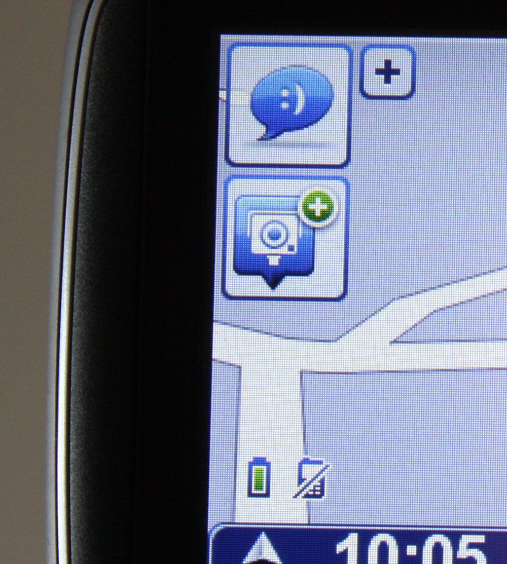 Det øverste ikonet viser at tilkoblet mobil har fått ny SMS. Det nederste lar deg legge til en fotoboks som ikke er på kartet.