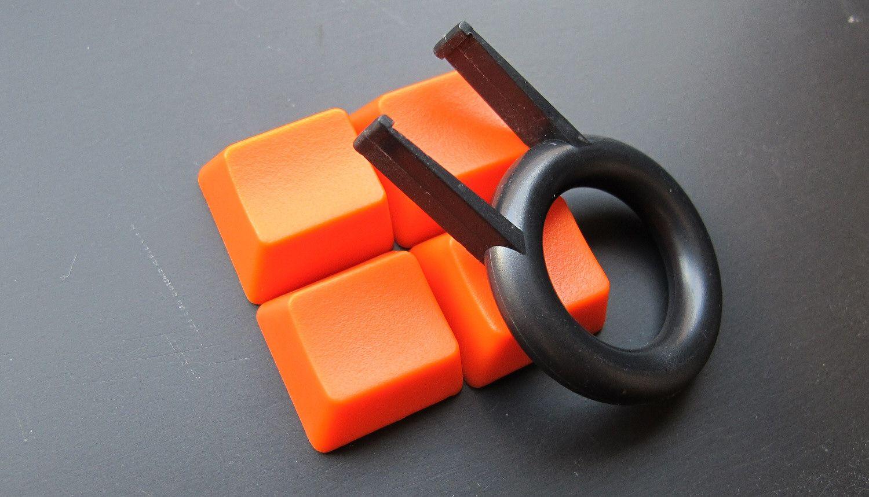 Det lille verktøyet gjør det til en lek å bytte om på tastehettene.