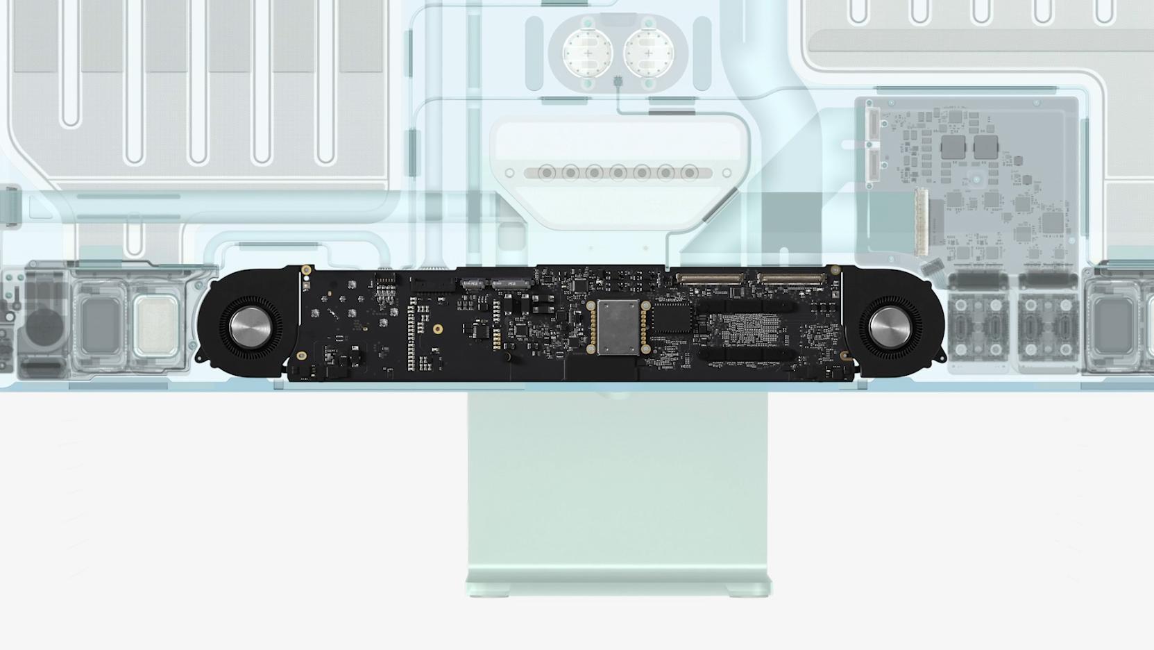Det nye kompakte hovedkortet, med M1-prosessoren og vifter på hver side.