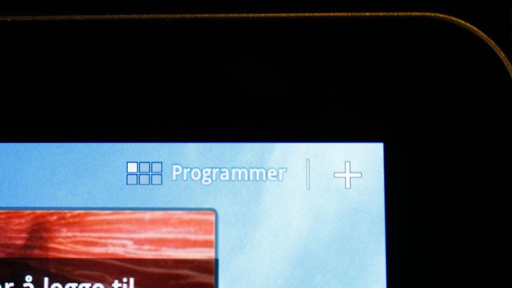 Her er snarveien til programmenyen. Trykk på plusstegnet for å administrere hjemmeskjermene.