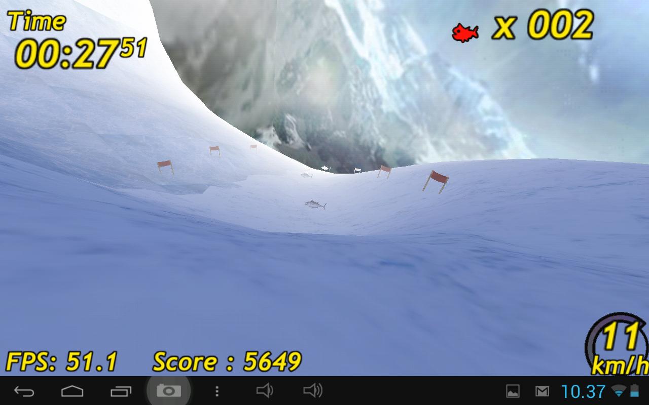 Ett spill følger med, Penguin Skiing. Her er du en pingvin som aker på magen ned en alpinbakke, mens du fanger fisk som henger i lufta ...Foto: Espen Irwing Swang