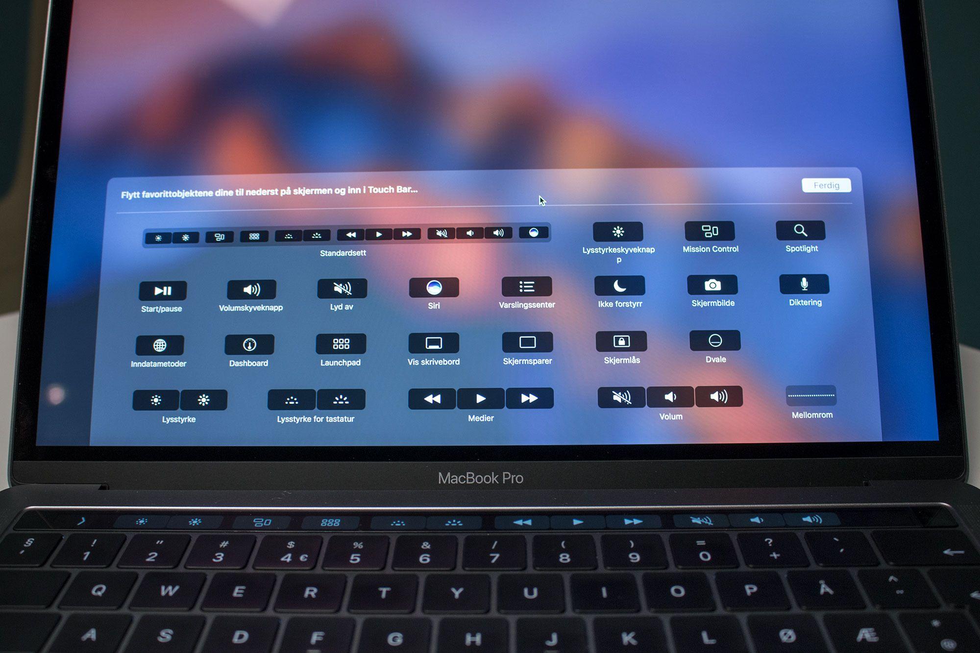 Disse funksjonene kan du bytte på å ha vise på Touch Baren din.