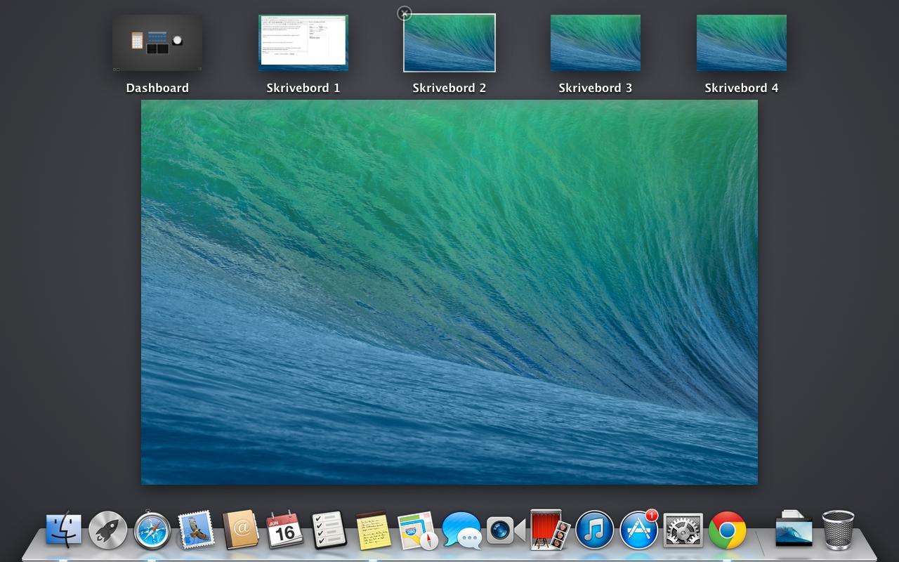 Hver skjerm får nå sitt eget sett med skrivebord, og en egen dock. Dette er vår bærbare.