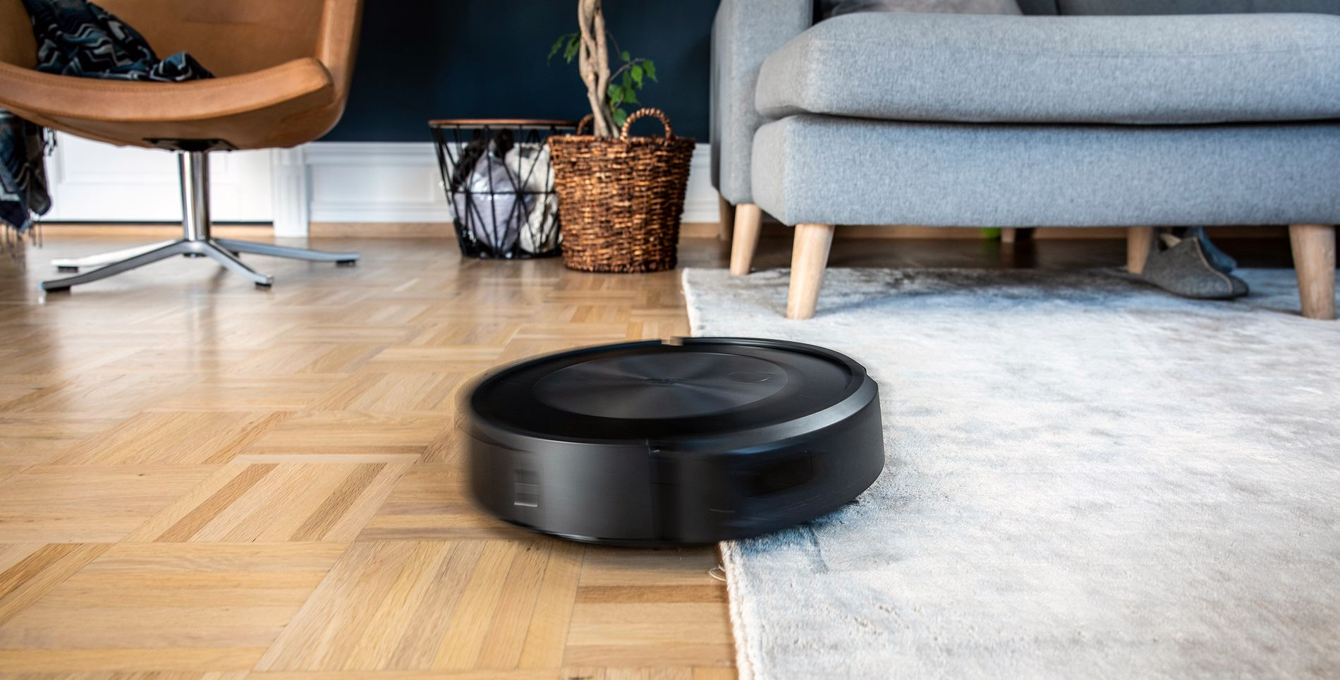 GETTING WHERE IT IS NEEDED: The robot vacuums rugs and crawls under the sofa.