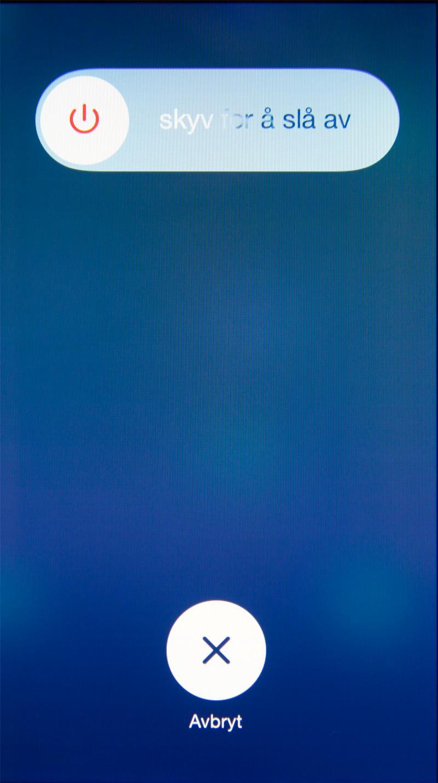 Apple har redesignet deler av iOS. Låseklossen er tilbake når du skal skru av telefonen.Foto: Kurt Lekanger, Amobil.no