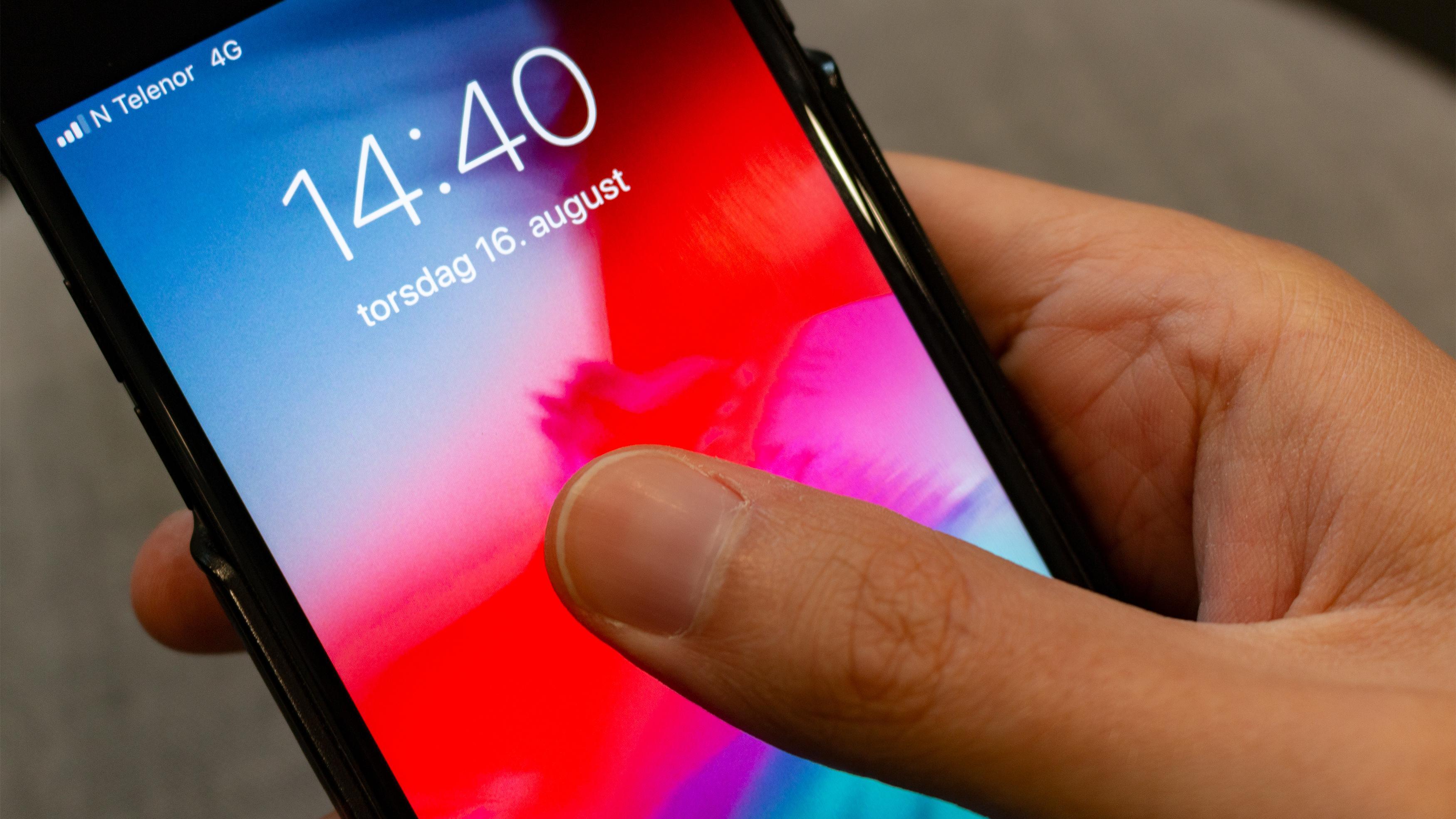 Fremtidens iPhone kan åpnes ved å legge fingeren på skjermen