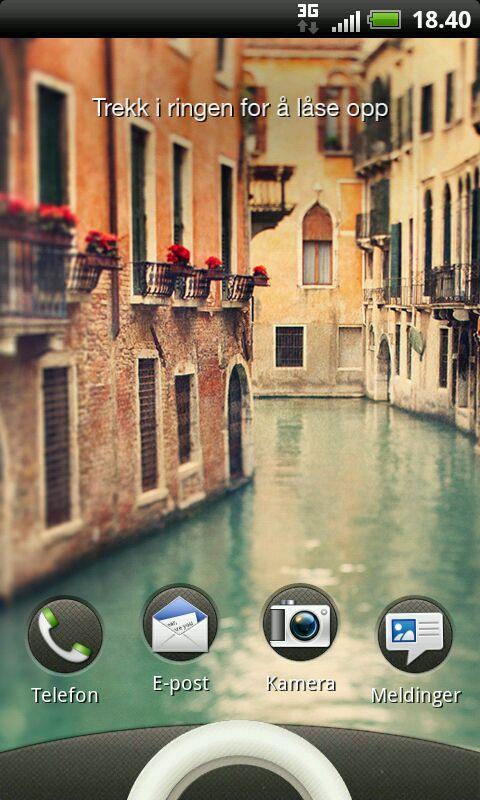 Slik ser tastelåsskjermen ut på HTC Rhyme.