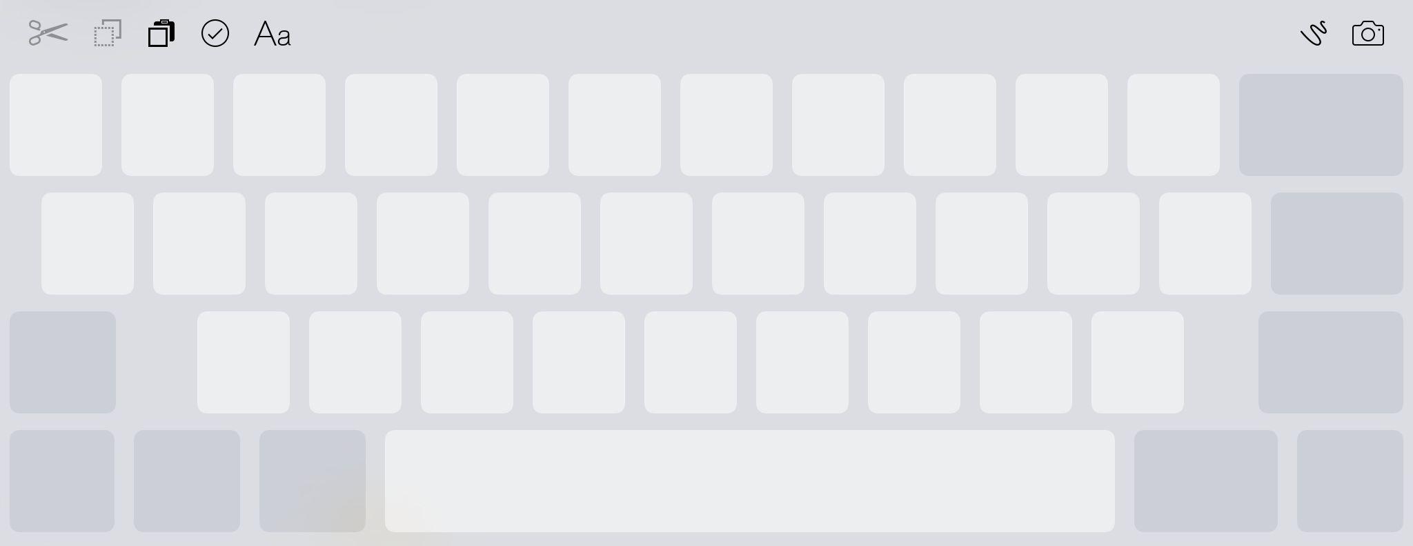 Med en gang du begynner å bruke to fingre på tastaturet, gråer bokstavene over og skjermen blir til en pekeplate som lar deg flytte markøren rundt. Funksjonen var meget god på iPad, men litt vanskeligere å bruke på en mindre iPhone-skjerm. Foto: Finn Jarle Kvalheim, Tek.no